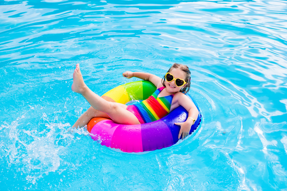 child floating in inflatable ring